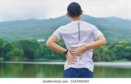 Back pain,sport injury concept.