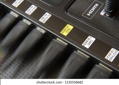 The back panel of the TV with the connectors of the electrical devices. USB and HDMI cables plugged into TV slots.