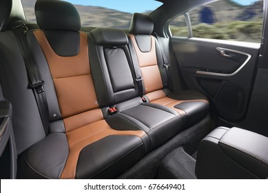 Back passenger seats in modern luxury car, frontal view,