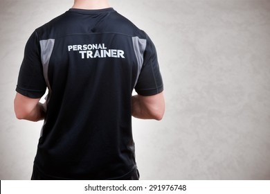 Back of a Personal Trainer isolated in grey