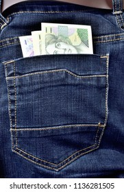 Back pocket of jeans full of czech banknotes, czech crowns - vertical photo