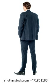 Back pose of businessman facing the wall.