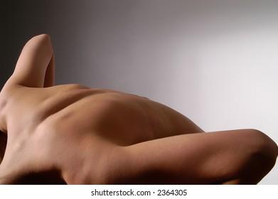 back of pretty woman bending down