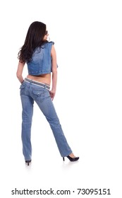 back of pretty young woman posing in jeans clothing, isolated on white