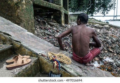 Back of a rag picker on the Ganges shore in Kolkata, India