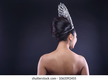 Back rear side view Portrait of Miss Pageant Beauty Contest in Red sequin Evening Ball Gown with Diamond Crown, Asian Woman fashion make up black hair style, studio lighting dark background copy space