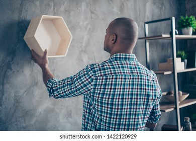 Back rear side view portrait of focused professional have shelf occupation lumber antique hang dressed casual checked shirt stand plaid room apartment