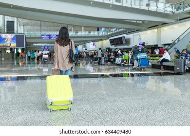 Back rear view of woman in airport