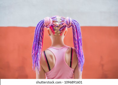 back, rear view of woman with colorful violet, pink dreadlocks. Tenderness