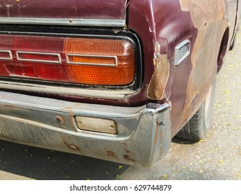 The back of the rusty old car
