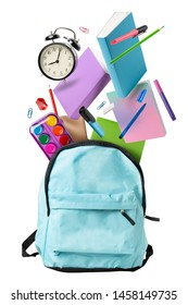 Back to school 1 September. Backpack and flying books, notebooks, pencils and alarm clock isolated on white