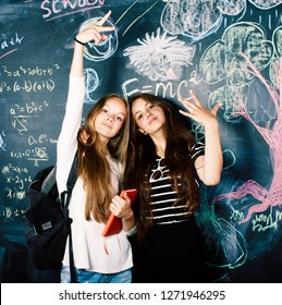 back to school after summer vacations, two teen real girls in cl