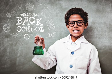 back to school against cute boy holding conical flask in classroom