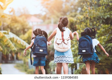 Back to school. Asian  pupil kids with backpack going to school together in vintage color tone
