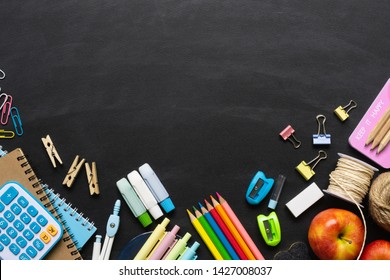 Back to School background concept. School supplies on a chalkboard background. Education background concept with copyspace. View from above. Flat lay.