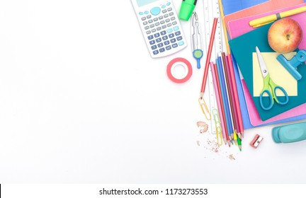 back to school background with school items and copy space on white.