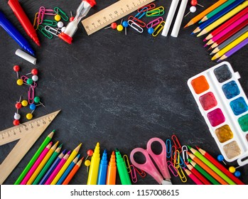 Back to school Background. School supplies on black chalk board. Flat lay