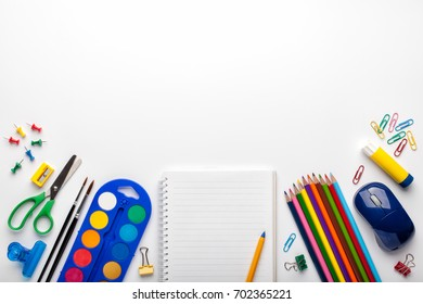 Back to school background with school supplies on white table.