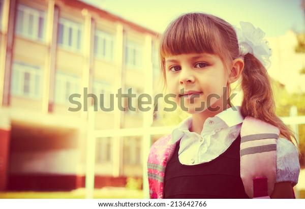 Back to school - beautiful small schoolgirl, education concept