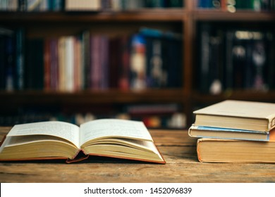 Back to school. The book in the library (school, university, college) on the table. Reading, literature, learning and study concept. Copy space.