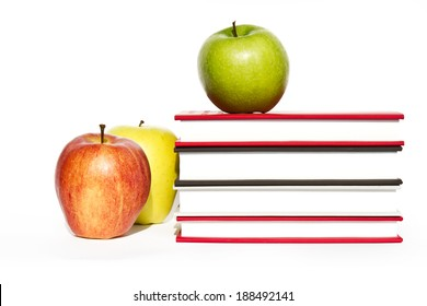 Back to school. Books and apple isolated on white background
