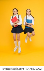 Back to school. Bring child school few days prior play playground and get comfortable. Cheerful school girls. Point out positive aspects starting school create positive anticipation first day class.