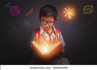Back to school, Child opened a magic book, Image dark tone