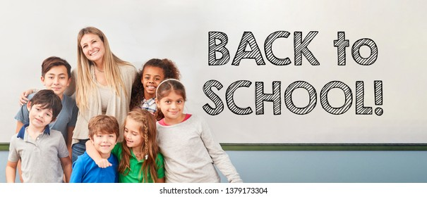 Back to school with children of a school class and a teacher in elementary school
