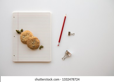 Back to School Chocolate Chip Cookies and Cannabis Buds on a Binder Paper Plate with a Red Pencil and Clips