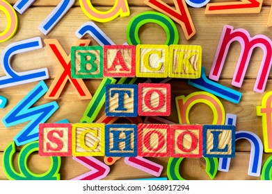 """Back to school. Close up arrangement of """"Back to School"""" alphabet on wooden background. Preschool, education, back to school and copy-space concept or other your content."""