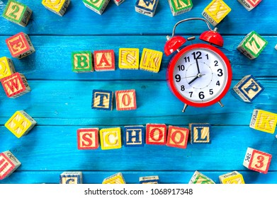 """Back to school. Close up arrangement of """"Back to School"""" alphabet on blue background. Preschool, education and copy-space concept or other your content."""