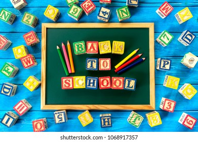 """Back to school. Close up arrangement of """"Back to School"""" alphabet on chalk board. Preschool, education and copy-space concept or other your content."""