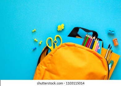 Back to school concept. Backpack with school supplies. Top view. Copy space
