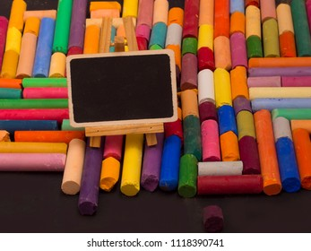 back to school concept, blackboard with colorful crayons