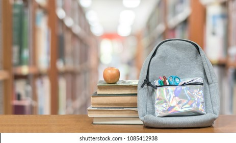 Back To School Concept With School Books, Textbooks, Backpack And  Stationery Supplies On Classroom