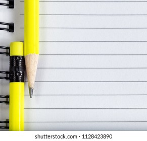 Back to school concept with close up of pencil tip and eraser on notebook paper