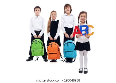 Back to school concept with kids holding colorful schoolbags - isolated