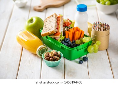 Back to school concept - lunch box with juice, apple and banana, copy space