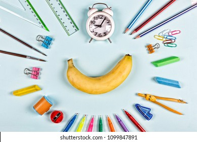 Back to school concept. minimalism. school snack banana and school supplies. Flat lay stylish set top view. copy space.