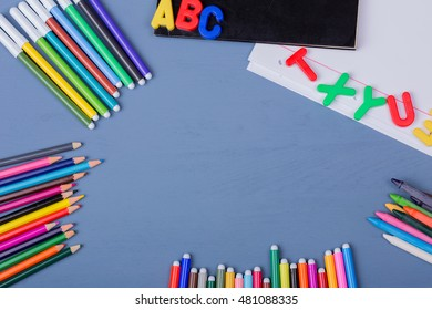Back to school concept on a blue wooden background