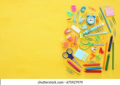 Back To School Concept On Yellow Wooden Background. Top View