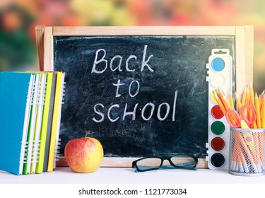 Back to school concept poster.Blackbord with school supplies.