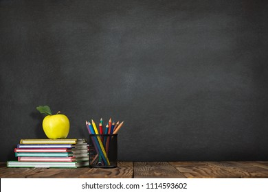 Back to School Concept with Stationery Supplies and Blackboard