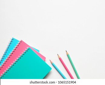 Back to school concept, school supplies, top view of colorful pastel notebooks and pencils on light grey background