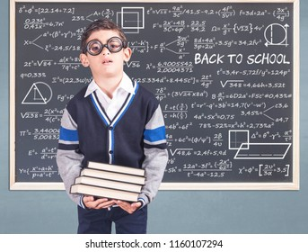 Back to school concept with tired geek student in classroom