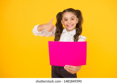 Back to school concept. Upcoming event. Look here. Girl school uniform hold poster. Changes coming. Schoolgirl pupil show poster. Schoolgirl hold poster copy space. News information promotion.