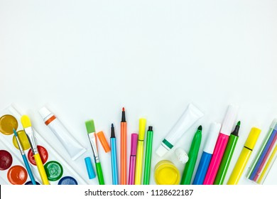 back to school concept. variety of bright kids stationary on white background