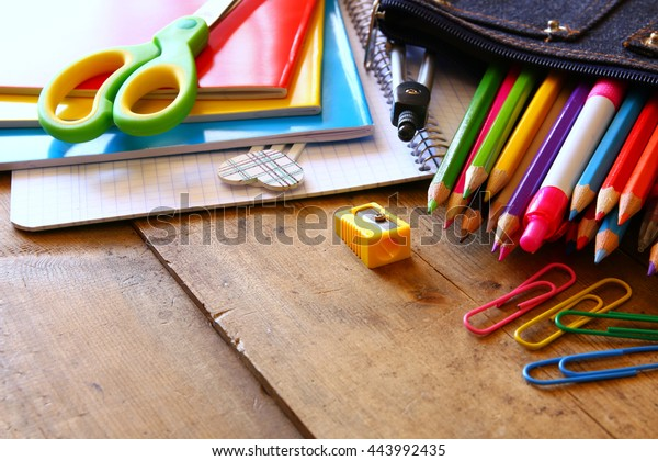 Back to school concept. Writing supplies on the table.