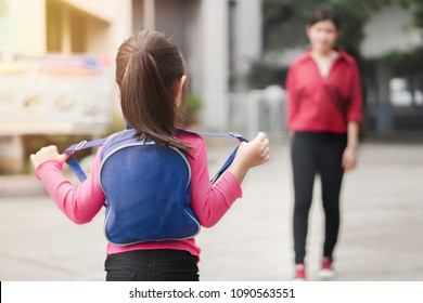 Back to school concept,Asian mother or parent taking daughter to school, asian girl carrying backpack prepare go to kindergarten in morning time, Selective focus