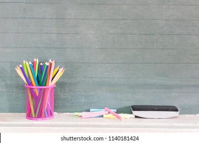 Back to school concept.Colorful pencils  classroom blackboard